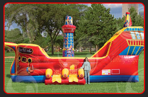 <strong>THE BUCCANEER</strong> – 27'x16'x17'<br/>Our latest combo features the look of a Spanish Galleon on the high seas. Designed as a combination climb slide and bouncer, the Buccaneer™ is a true favorite for children of all ages.