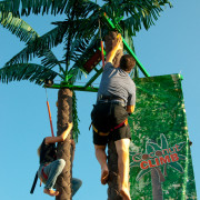 <strong>Jungle Climb</strong><br/>The Jungle Climb is a unique and innovative twist on the traditional rock wall.  The realistic trunk and leaf fronds make a grand centerpiece on these 26' palm trees.  Onlookers will enjoy cheering kids and adults as they race or climb to the top.  This challenging climb is aided by an auto-belay system and 3-point safety harnesses.