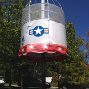 "<strong>NASA Kiddie Shuttle</strong><br/>The NASA Kiddie Shuttle is an incredible piece for elementary school riders.  The capsule has an enclosed, padded seating area and spins while moving sporadically up and down the 10' pole.  This ""mini-drop zone"" for kids is an awesome choice for any event and has a smaller footprint when space is an issue.  This pairs well with the Rascal Rocket."