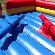 <strong>Gladiator Joust Arena</strong><br/> Try to stay on your pad as long as possible and knock off your opponent in true gladiator style. Inflatable arena comes with two jousting poles and headgear. This is a perfect choice for older children, middle school fun days or high school events. Adults can use it at teambuilding competitions or corporate picnics.