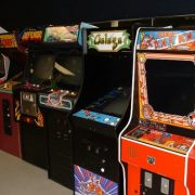 <strong>Awesome 80s Arcade</strong><br>JumpWorks is bringing back the decade of pegged jeans and big hair with classic 80s arcades.  Relive the days of Pac-Man, Zelda, Donkey Kong and Frogger on old school machines and set up a totally rad arcade at your next event.  We offer multicades, pinballs, driving games and claw cranes to accommodate all needs.  Boombox optional, but no quarters required!