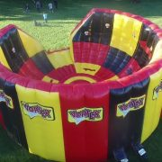 <strong>The Vortex</strong><br>The Vortex provides competitive excitement for kids, teens and adults.  Teams Red and Green race up the side of the Vortex to touch the LED lights of their respective team color.  No two games are the same and players never know where their light will appear next.  Good for all ages.  34' X 18' space required.